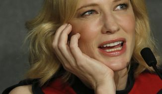 Actress Cate Blanchett answers questions during a photo call for How to Train Your Dragon 2 at the 67th international film festival, Cannes, southern France, Friday, May 16, 2014. (AP Photo/Alastair Grant)