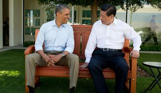 """The President sits with President Xi Jinping of China on an inscribed redwood park bench at the Annenberg Retreat at Sunnylands in Rancho Mirage, Calif. The two leaders spent two days in bilateral talks at Sunnylands.""