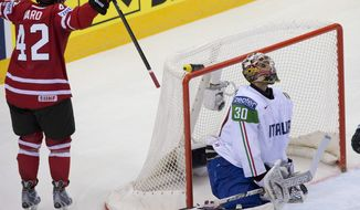 Canada's Joel Ward celebrates the first goal he scored against Italy goalie Daniel Bellissimo during the first period at the IIHF World Hockey Championship Friday, May 16, 2014, in Minsk, Belarus. (AP Photo/The Canadian Press, Jacques Boissinot)