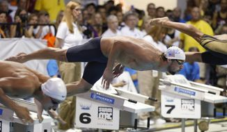 Michael Phelps dives in at the start of the 100-meter butterfly at the Arena Grand Prix swim meet in Charlotte, N.C., Friday, May 16, 2014. Phelps won the race. (AP Photo/Nell Redmond)