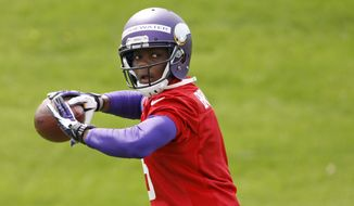 Quarterback Teddy Bridgewater drops back to pass during Minnesota Vikings minicamp in Eden Prairie, Minn., Friday, May 16, 2014. New Vikings coach Mike Zimmer set to work getting young players like Bridgewater, linebacker Anthony Barr and defensive backs Antone Exum and Kendall James up to speed on what will be expected of them in the NFL.  (AP Photo/Ann Heisenfelt)