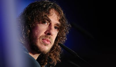FC Barcelona's Carles Puyol pauses, during a press conference at the Nou Camp stadium in Barcelona, Spain, Thursday, May 15, 2014. Puyol reluctantly quit football on Thursday,  his knees no longer able to endure the demands of the Barcelona defense after 15 years, the most successful period in the club's history. (AP Photo)