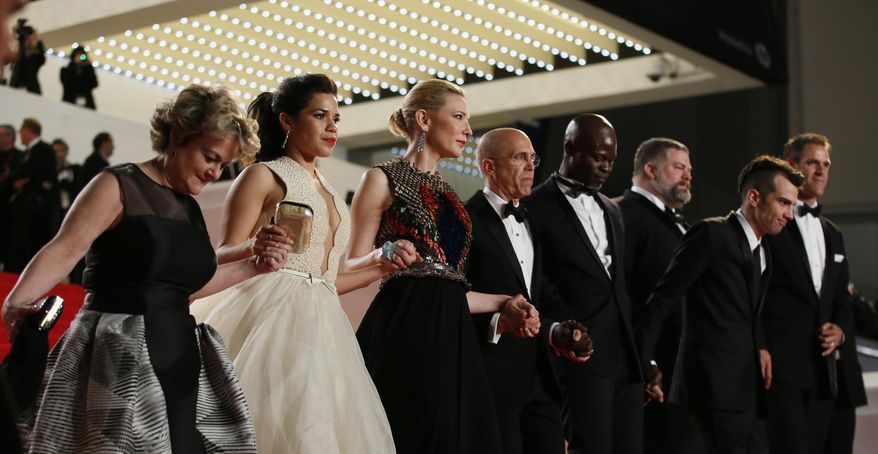 From left, producer Bonnie Arnold, actress America Ferrera, actress Cate Blanchett, head of Dreamworks Jeffrey Katzenberg, actor Djimon Hounsou,director Dean Deblois and actor Jay Baruchel leave after the screening of Captives at the 67th international film festival, Cannes, southern France, Friday, May 16, 2014. (AP Photo/Alastair Grant)