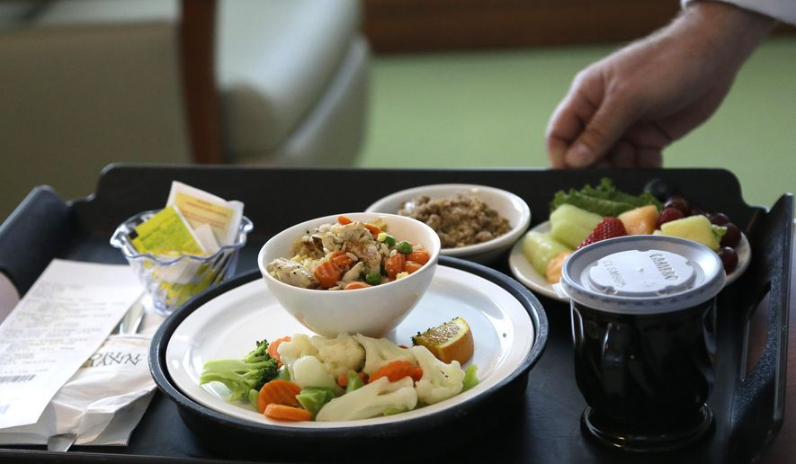 A heart healthy lunch of chicken fried rice, vegetables, fruit and dessert is served to a heart patient Thursday, May 1, 2014, at Houston's Memorial Hermann Southwest Hospital. Menu changes are one way to care for an increasingly diverse population that hails from regions once not typical to the Houston area. (AP Photo/Pat Sullivan)