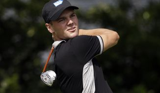 Martin Kaymer, of Germany, watches his shot off the fourth tee during the second round of the Byron Nelson Championship golf tournament, Friday, May 16, 2014, in Irving, Texas. (AP Photo/Tony Gutierrez)