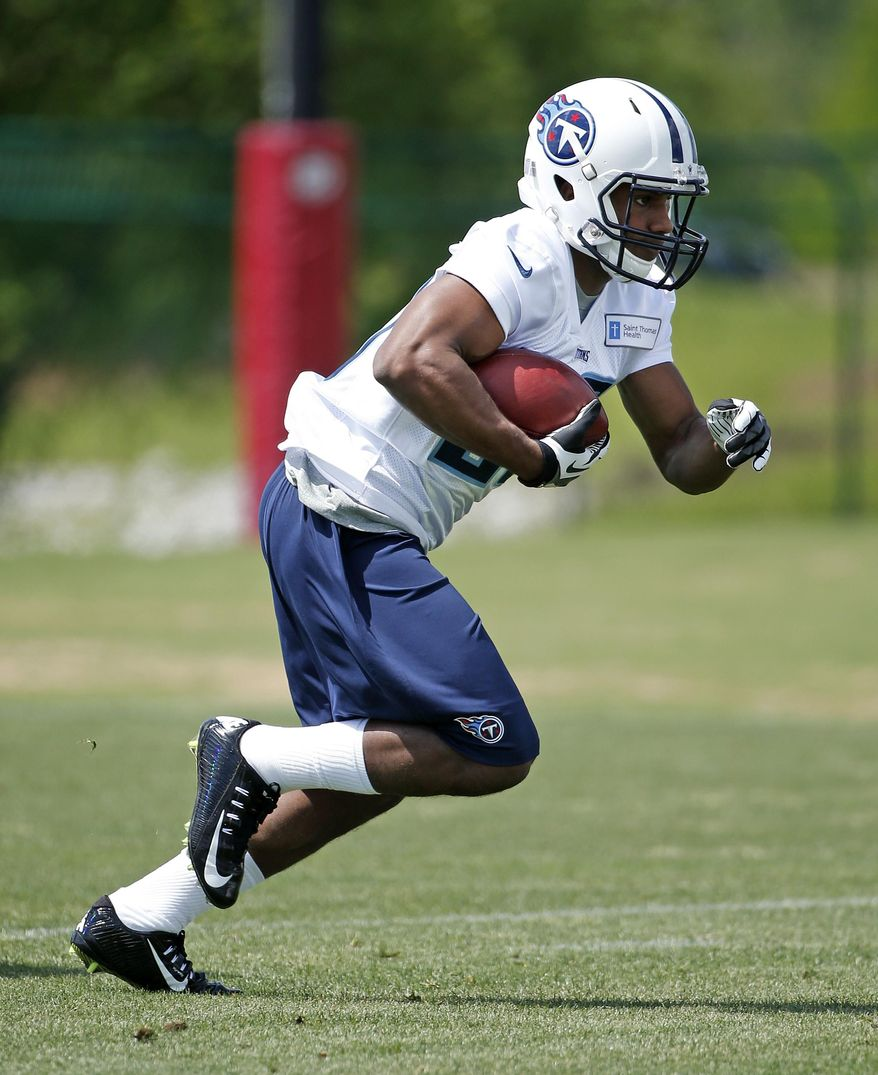Tennessee Titans rookie running back Bishop Sankey runs a drill during NFL football rookie camp on Friday, May 16, 2014, in Nashville, Tenn. The opportunity and pressure are there for Sankey to become a starter replacing Chris Johnson, even though NFL rules mean he'll miss a chunk of the team's offseason program. (AP Photo/Mark Humphrey)