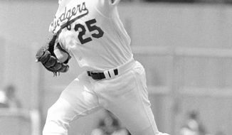 FILE - In this April 14, 1978, file photo, Los Angeles Dodgers left-hander Tommy John delivers a pitch against Atlanta Braves during an opening day baseball game in Dodgers Stadium, Los Angeles. UCL has increased 10-fold in the first decade of the 21st century, Dr. James Andrews, one of the world's top orthopedic doctors, and and Dr., Jeremy Bruce wrote in the May issue of the Journal of the American Academy of Orthopaedic Surgeons, citing a paper published by J.R. Dugas in 2010. Dr. Andrews will be meeting with a research committee on Monday at Major League Baseball's headquarters.  (AP Photo/LM, File)