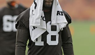 FILE - In this May 1, 2014, file photo, Cleveland Browns wide receiver Greg Little walks off the field after a voluntary minicamp workout at the NFL football team's facility in Berea, Ohio. The Browns have released the inconsistent wide receiver on Friday, May 16, 2014. (AP Photo/Mark Duncan, File)