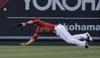 Los Angeles Angels center fielder Mike Trout catches a fly ball hit by Tampa Bay Rays' Logan Forsythe during the first inning of a baseball game in Anaheim, Calif., Thursday, May 15, 2014. (AP Photo/Chris Carlson)