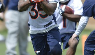 Denver Broncos' Kapri Bibbs runs a drill  during NFL football rookie camp, Friday, May 16, 2014, in Englewood, Colo.