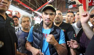 Juan Manuel Marquez, of Mexico, poses in the ring during a media workout at a boxing club in Bell, Calif., Wednesday, May 14, 2014. He and Mike Alvarado are preparing for their WBO welterweight title elimination bout at the Forum in Inglewood, Calif., Saturday. The winner will become the mandatory challenger to WBO welterweight champion Manny Pacquiao. (AP Photo/Nick Ut)