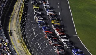 Cars approach the start of the NASCAR Truck series auto race in Concord, N.C., Friday, May 16, 2014. (AP Photo/Gerry Broome)