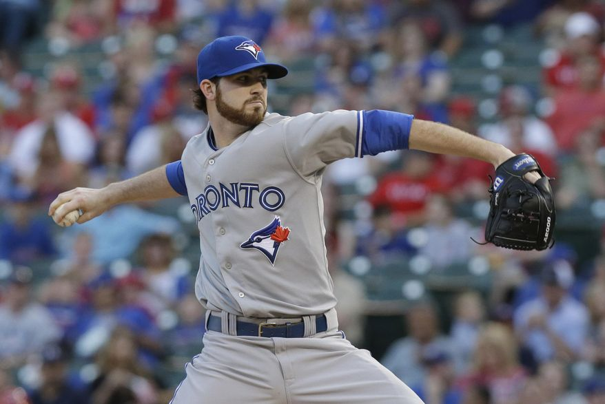 Toronto Blue Jays starting pitcher Drew Hutchison throws during the second inning of a baseball game against the Texas Rangers Jays in Arlington, Texas, Friday, May 16, 2014. (AP Photo/LM Otero)