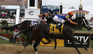 Stopchargingmaria with Javier Castellano atop wins the Black-Eyed Susan Stakes horse race as Vero Amore with Frank Pennington riding places at Pimlico Race Course, Friday, May 16, 2014, in Baltimore. The 139th Preakness horse race takes place Saturday. (AP Photo/Mike Stewart)