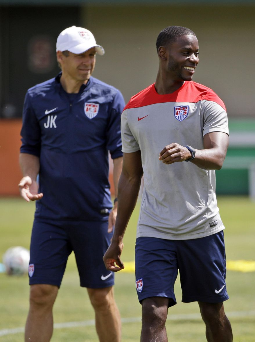 United States' Maurice Edu, right, smiles next to head coach Jurgen Klinsmann during a training session in preparation for the World Cup soccer tournament on Friday, May 16, 2014, in Stanford, Calif. (AP Photo/Marcio Jose Sanchez)