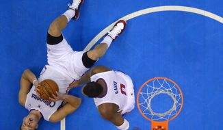 Los Angeles Clippers forward Blake Griffin, left, lays on the floor after committing a foul as forward Glen Davis tries to help him up in the second half of Game 6 of the Western Conference semifinal NBA basketball playoff series against the Oklahoma City Thunder, Friday, May 16, 2014, in Los Angeles. The Thunder won 104-98, taking the series 4-2.  (AP Photo/Mark J. Terrill)