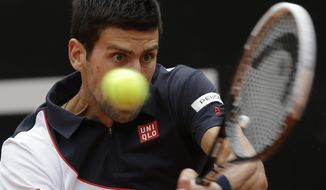 Serbia's Novak Djokovic returns the ball to Spain's David Ferrer during their quarterfinal match at the Italian Open tennis tournament, in Rome, Friday, May 16, 2014. (AP Photo/Alessandra Tarantino)