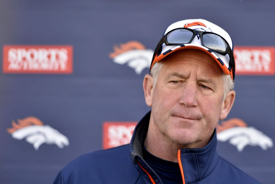 Denver Broncos head coach John Fox looks on during a news conference following NFL football rookie camp, Friday, May 16, 2014, in Englewood, Colo.  (AP Photo/Jack Dempsey)