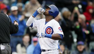 Chicago Cubs' Junior Lake celebrates after hitting a solo home run against the Milwaukee Brewers during the third inning of a baseball game on Friday, May 16, 2014, in Chicago. (AP Photo/Andrew A. Nelles)