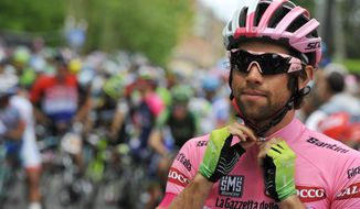 Overall leader Michael Matthews prepares at the start of the seventh stage of the Giro d'Italia, Tour of Italy cycling race, from Frosinone to Foligno, Italy, Friday May 16, 2014.  (AP Photo/Gian Mattia D'Alberto)