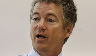 Sen. Rand Paul, R-Kentucky, speaks during a round table discussion on school choice at Carpe Diem-Aiken, a tuition-free public charter school, Friday, May 16, 2014, in Cincinnati. (AP Photo/Al Behrman)