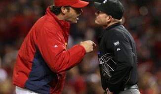 St. Louis Cardinals manager Mike Matheny argues with home plate umpire Sean Barber after Barber ejected center fielder Peter Bourjos in fourth inning against the Atlanta Braves in a baseball game Friday, May 16, 2014, at Busch Stadium in St. Louis. (AP Photo/St. Louis Post-Dispatch, Chris Lee) EDWARDSVILLE OUT  ALTON OUT