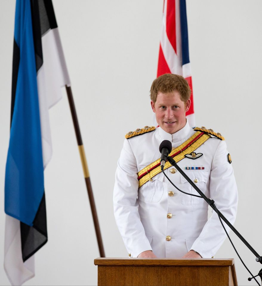 Britain's Prince Harry speaks at a meeting with Estonian lawmakers and wounded soldiers from Estonia's army units, which served primarily under British command during their 11-year deployment in Afghanistan, in Tallinn, Estonia, Friday, May 16, 2014.  Hundreds of people lined the streets of Tallinn, waving British flags as Harry, in military regalia, marched to the capital's central Freedom Square accompanied by soldiers of the Duke of Lancaster's Regiment.(AP Photo/Liis Treimann)