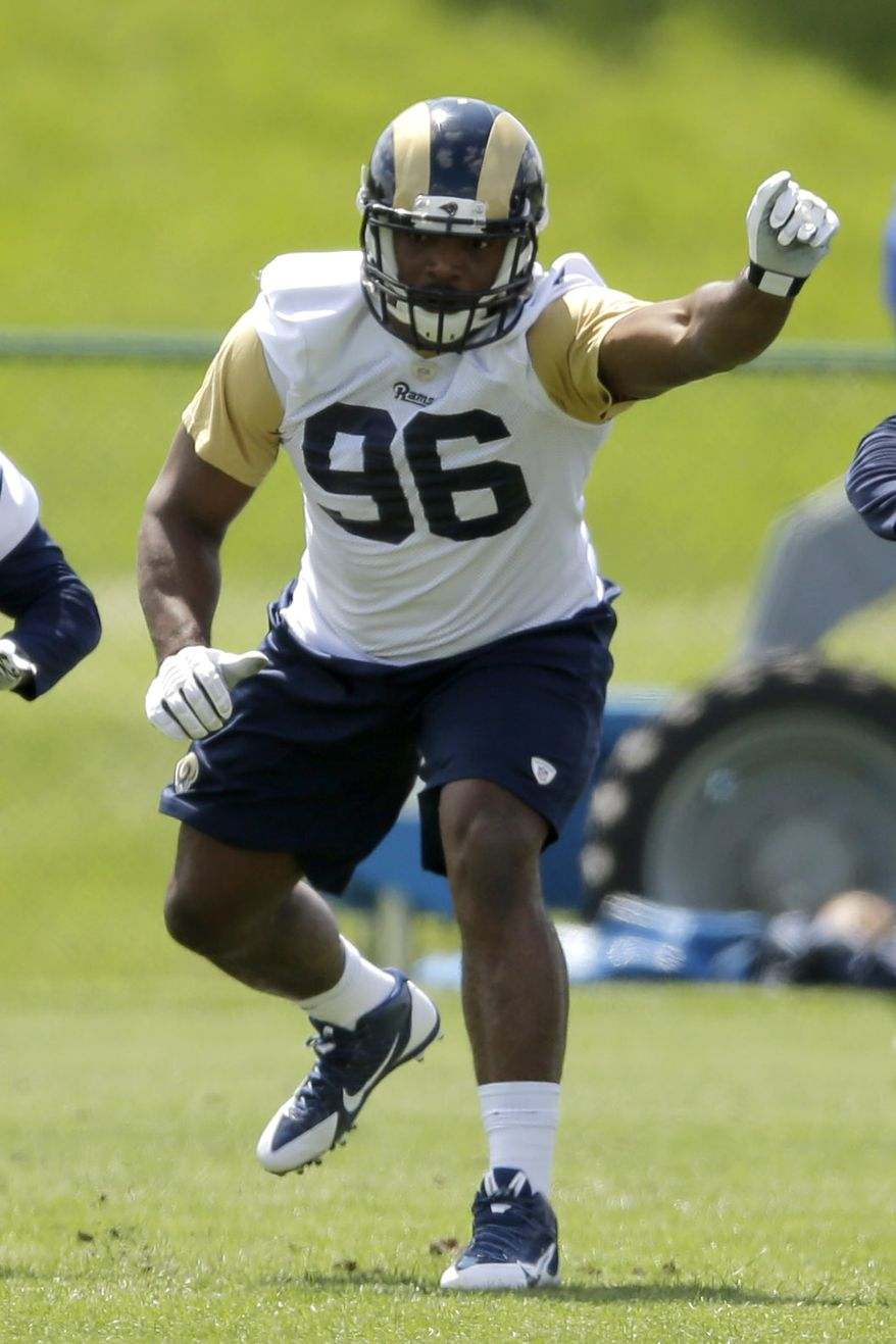 St. Louis Rams seventh-round draft pick Michael Sam takes part in a drill during a rookie mini camp at the NFL football team's practice facility Friday, May 16, 2014, in St. Louis. (AP Photo/Jeff Roberson)