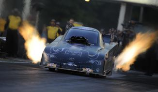 In this photo submitted by the NHRA, Alexis DeJoria secures the No. 1 qualifying position in Funny Car for the Summit Racing Equipment NHRA Southern Nationals at Atlanta Dragway, Saturday, May 17, 2014, in Commerce, Ga. This is her first career No. 1 qualifier. She will face Tony Pedregon when eliminations begin on Sunday. (AP Photo/NHRA, Marc Gewertz)