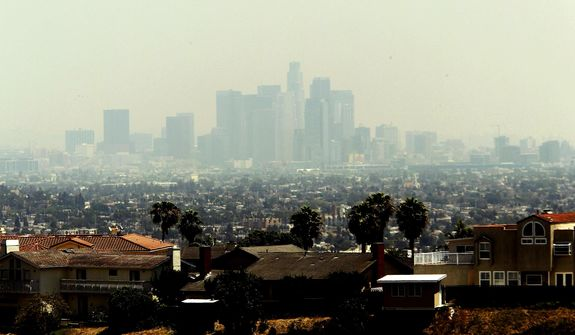 A smoky haze obscures the Los Angeles skyline Friday May 16, 2014. Smoke from several wildfires that have burned more than 1, 500 acres in Southern California have drifted north into the city.(AP Photo/Nick Ut)