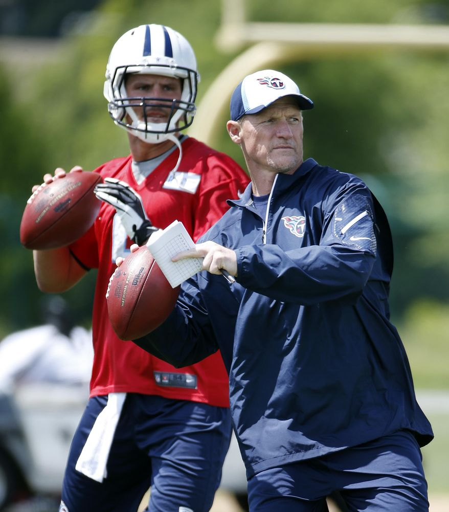 Tennessee Titans head coach Ken Whisenhunt throws to a receiver along with tryout quarterback Drew Allen, left, during NFL football rookie minicamp on Friday, May 16, 2014, in Nashville, Tenn. (AP Photo/Mark Humphrey)