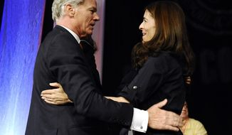 Republican candidate for governor Tom Foley, left, embraces wife Leslie Fahrenkopf Foley, after accepting the nomination for governor at the Connecticut Republican Convention, Saturday, May 17, 2014, in Uncasville, Conn. (AP Photo/Jessica Hill)