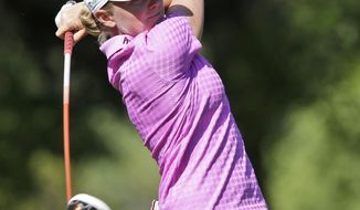 Stacy Lewis watches her tee shot on the ninth hole during the third round of the Kingsmill Championship golf tournament at the Kingsmill resort  in Williamsburg, Va., Saturday, May 17, 2014.   (AP Photo/Steve Helber)