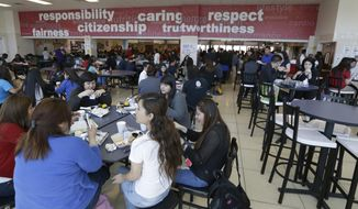 Students eat their lunch in the cafeteria at Thomas Jefferson High School in Dallas, Friday, April 18, 2014. (AP Photo/LM Otero) ** FILE **