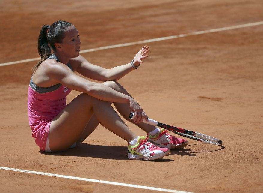 Serbia's Jelena Jankovic sits on the court after losing a point during her semifinal match against Italy's Sara Errani at the Italian open tennis tournament in Rome, Saturday, May 17, 2014. (AP Photo/Gregorio Borgia)
