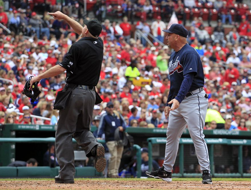 Atlanta Braves manager Fredi Gonzalez, right, ejected from the game while arguing with home plate umpire Ron Kulpa, left, during the fifth inning of a baseball game against the St. Louis Cardinals on Saturday, May 17, 2014, in St. Louis. (AP Photo/Jeff Roberson)