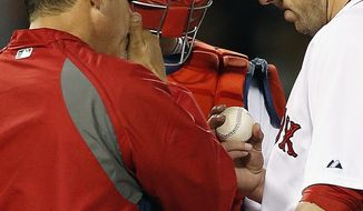 Boston Red Sox's John Lackey, right, has a conference on the mound with pitching coach Juan Nieves, left, and A.J. Pierzynski in the fifth inning of a baseball game against the Detroit Tigers in Boston, Saturday, May 17, 2014. (AP Photo/Michael Dwyer)