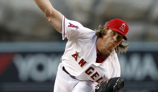 Los Angeles Angels starting pitcher Jered Weaver throws against the Tampa Bay Rays in the first inning of a baseball game on Friday, May 16, 2014, in Anaheim, Calif. (AP Photo/Alex Gallardo)