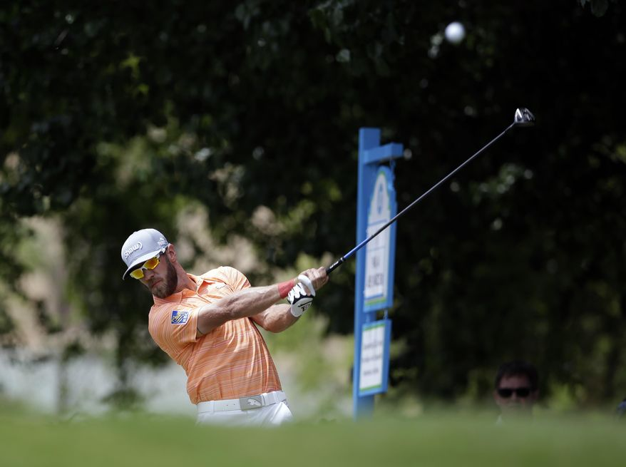 Graham DeLaet hits off the first tee during the third round of the Byron Nelson Championship golf tournament, Saturday, May 17, 2014, in Irving, Texas. (AP Photo/Tony Gutierrez)