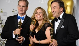 """FILE - In a Sunday, March 2, 2014 file photo, Chris Buck, from left, Jennifer Lee and Peter Del Vecho  pose in the press room with the award for Best animated feature film of the year for """"Frozen"""" during the Oscars at the Dolby Theatre, in Los Angeles. On Saturday, May 17, 2014, Lee, speaking at the University of New Hampshire commencement, encouraged University of New Hampshire graduates to do away with self-doubt. (Photo by Jordan Strauss/Invision/AP, File)"""