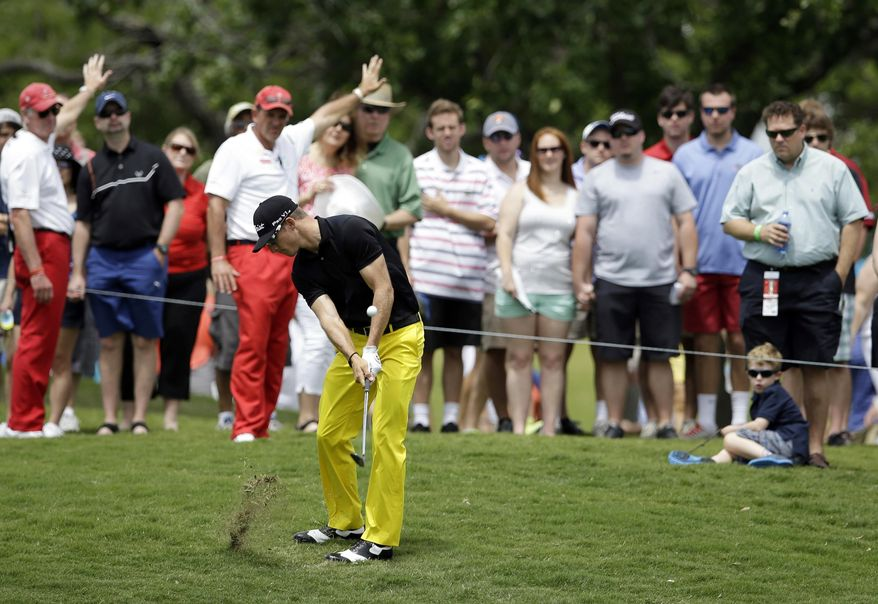 Morgan Hoffman hits out of the rough onto the second green during the third round of the Byron Nelson Championship golf tournament, Saturday, May 17, 2014, in Irving, Texas. (AP Photo/Tony Gutierrez)