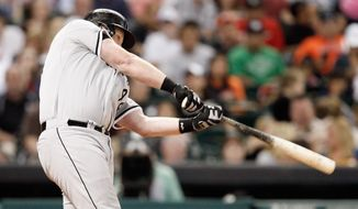 Chicago White Sox's Adam Dunn hits a three-run home run in the sixth inning against the Houston Astros during a baseball game on Friday, May 16, 2014, in Houston. (AP Photo/Bob Levey)