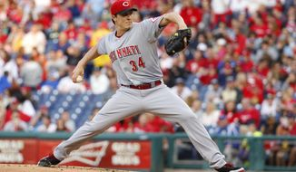 Cincinnati Reds starting pitcher Homer Bailey delivers during the first inning of a baseball game against the Philadelphia Phillies, Saturday, May 17, 2014, in Philadelphia. (AP Photo/Chris Szagola)
