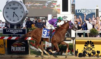California Chrome, ridden by jockey Victor Espinoza, wins the 139th Preakness Stakes horse race at Pimlico Race Course, Saturday, May 17, 2014, in Baltimore.  (AP Photo/Mike Stewart)