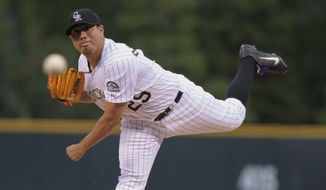 Colorado Rockies starting pitcher Jorge De La Rosa throw to a San Diego Padres batter in the first inning of a baseball game in Denver, Friday, May 16, 2014. (AP Photo/Joe Mahoney)