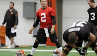 Cleveland Browns quarterback Johnny Manziel (2) stretches before a rookie minicamp practice at the NFL football team's facility in Berea, Ohio Saturday, May 17, 2014. (AP Photo/Mark Duncan)