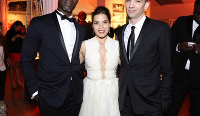 Actors Djimon Hounsou, America Ferrera and Jay Baruchel pose for photographers during the party for the film How To Train Your Dragon 2 at the 67th international film festival, Cannes, southern France, Friday, May 16, 2014. (Photo by Arthur Mola/Invision/AP)