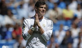 Real Madrid's Gareth Bale from Wales gestures during a Spanish La Liga soccer match between Real Madrid and Espanyol at the Santiago Bernabeu stadium in Madrid, Spain, Saturday, May 17, 2014 . (AP Photo/Daniel Ochoa de Olza)