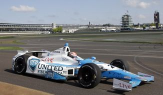 James Hinchcliffe, of Canada, drives through the first turn during practice on the first day of qualifications for Indianapolis 500 IndyCar auto race at the Indianapolis Motor Speedway in Indianapolis, Saturday, May 17, 2014. (AP Photo/AJ Mast)