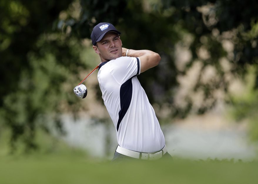 Martin Kaymer, of Germany, watches his shot off the first tee during the third round of the Byron Nelson Championship golf tournament, Saturday, May 17, 2014, in Irving, Texas. (AP Photo/Tony Gutierrez)